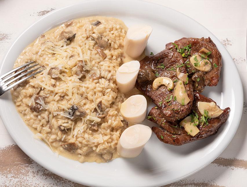 Risotto con hongos y palmito con filete a la mostaza